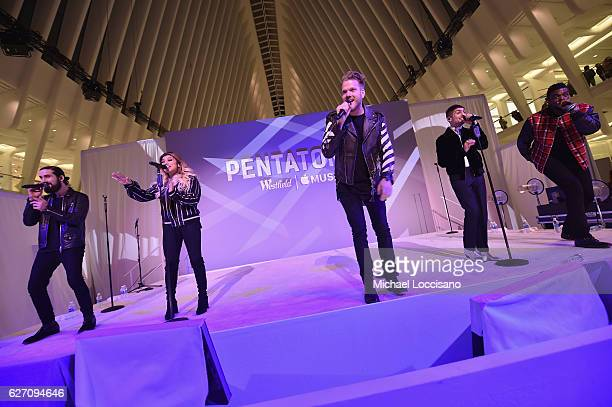 Avi Kaplan Kirstin Maldonado Scott Hoying Mitchell Grassi and Kevin Olusola of Pentatonix perform at Westfield World Trade Center Holiday Lights...