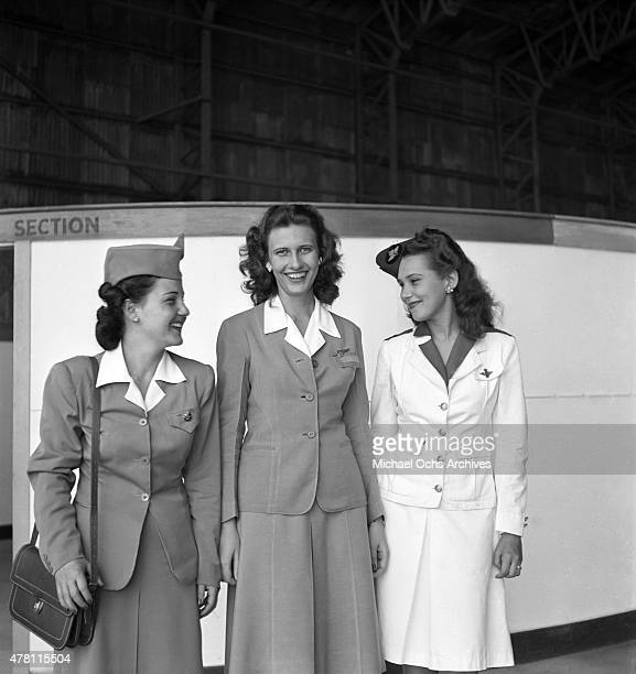 Avianca Airlines Pan American Airways and KLM Royal Dutch Airlines Stewardess pose for a photo at the airport circa 1947 in San Juan Puerto Rico