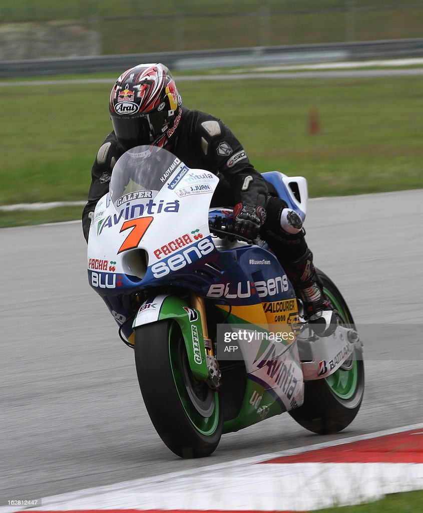 FTR Aviantia Blusens rider Hiroshi Ayoma of Japan rides to turn seven on the third day of the pre-season MotoGP test session at the Sepang circuit outside Kuala Lumpur on February 28, 2013. AFP PHOTO / Peter LIM