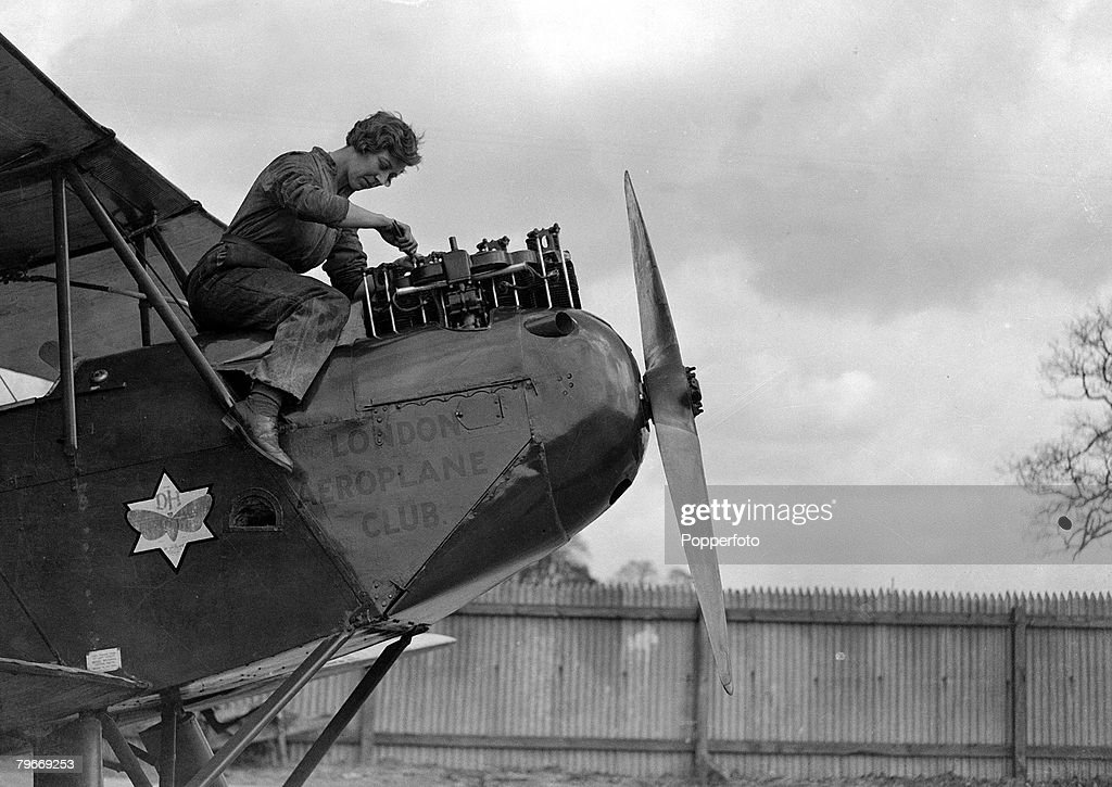 Aviation, London, 30th March, 1930, English pilot Miss Amy Johnson pictured resting from working on the engine of her De Havilland 'Moth' aeroplane at Stag Lane airport in Hendon prior to her attempt to break the England-Australia flight record, She is the world's first fully qualified female aviation mechanic