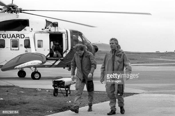 Aviation Minister Michael Spicer right at Sumburgh Airport after leaving a helicopter which took him on a flight over the scene of a Chinook...