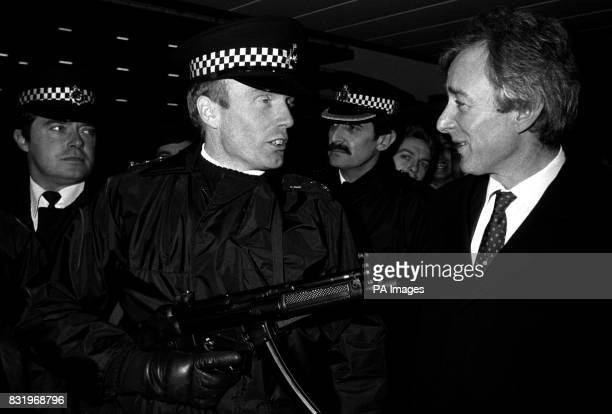 Aviation Minister Mr Michael Spicer with a member of Scotland Yard's D11 squad where the first sub machine guns to be carried by police on a routine...