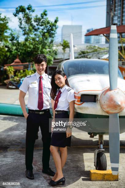 Aviation University students posing with airplane in Thailand