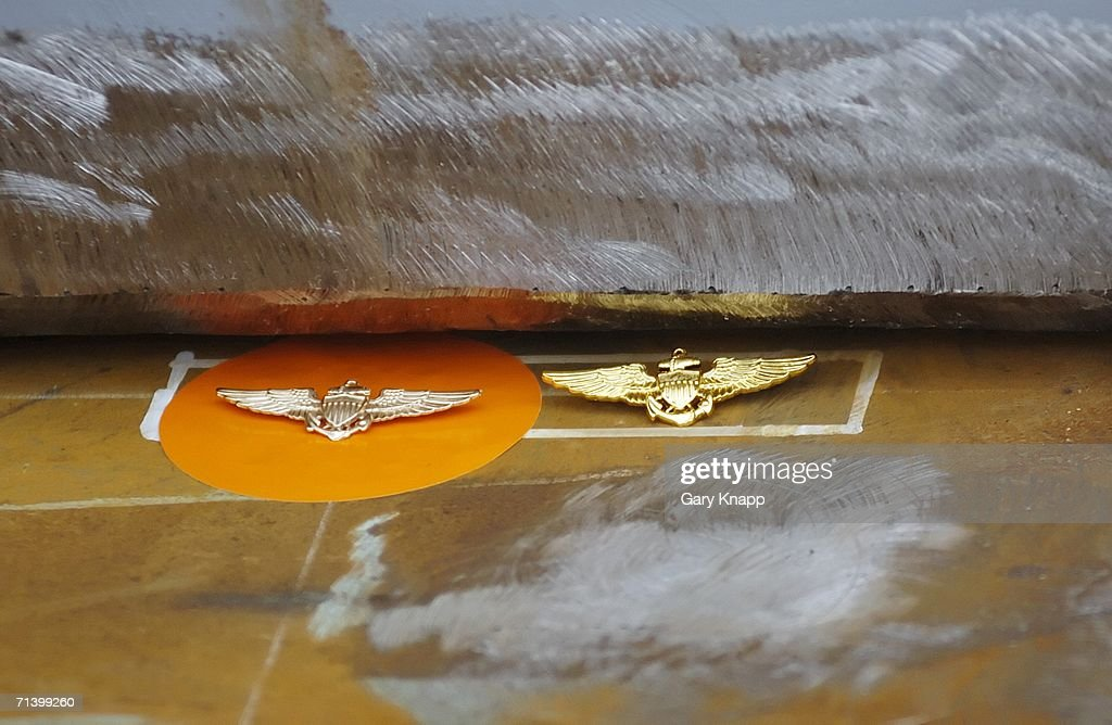 Aviator wings belonging to former US President George H W Bush and the perspective Commanding Officer of the aircraft carrier USS George H W Bush...