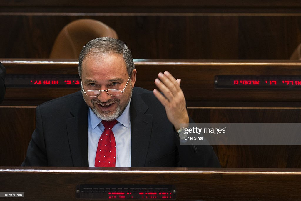 <a gi-track='captionPersonalityLinkClicked' href=/galleries/search?phrase=Avigdor+Lieberman&family=editorial&specificpeople=652650 ng-click='$event.stopPropagation()'>Avigdor Lieberman</a> smiles before he is sworn in as the Israeli foreign minister during a special Knesset (Israeli parliament) session on November 11, 2013 in Jerusalem, Israel. Lieberman was acquitted on corruption charges by the Magistrates Court in Jerusalem last week after a long-running trial.