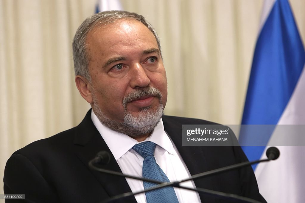 Avigdor Lieberman, the head of hardline nationalist party Yisrael Beitenu,is seen during a ceremony in which he signed a coalition agreement with Israeli prime minister on May 25, 2016 at the Knesset, the Israeli parliament in Jerusalem. A deal has been reached to bring far-right former foreign minister Avigdor Lieberman and his Yisrael Beitenu party into Israel's governing coalition pushing it further to the right. Prime Minister Benjamin Netanyahu will expand his coalition to 66 lawmakers and make Lieberman defence minister. / AFP / MENAHEM