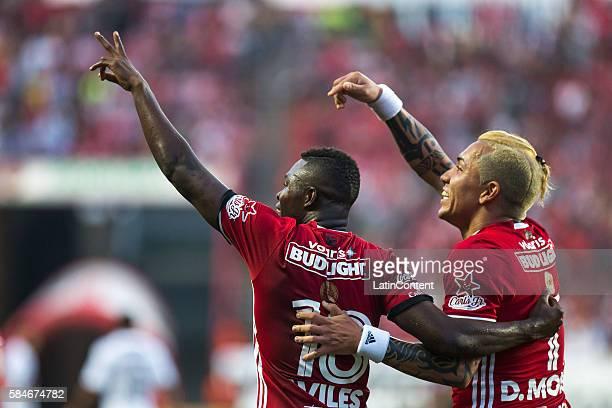 Aviles Hurtado and Dayro Moreno of Tijuana celebrate during the 3rd round match between Tijuana and Chivas as part of the Torneo Apertura 2016 Liga...