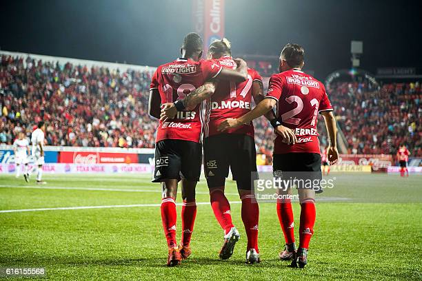 Aviles Hurtado Dayro Moreno and Kevin Gutierrez of Tijuana celebrate their team's second goal during the 14th round match between Tijuana and Chiapas...