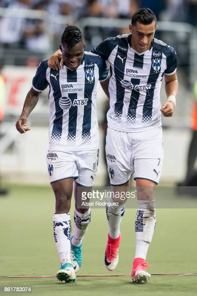Aviles Hurtado of Monterrey celebrate with teammate Rogelio Funes Mori after scoring his team's second goal during the 13th round match between...
