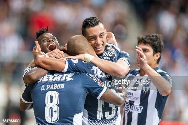 Aviles Hurtado of Monterrey celebrate with teammates after scoring his team's second goal during the 13th round match between Monterrey and Pachuca...