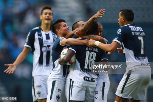 Aviles Hurtado of Monterrey celebrates with teammates after scoring the first goal of his team during the seventh round match between Cruz Azul and...