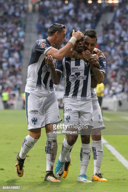Aviles Hurtado of Monterrey celebrates with teammates after scoring the opening goal during the 9th round match between Monterrey and Atlas as part...