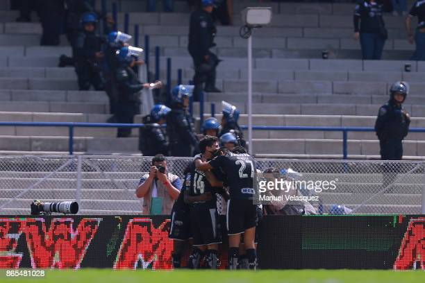 Aviles Hurtado of Monterrey celebrates with teammates after scoring the first goal of his team during the 14th round match between Pumas UNAM and...