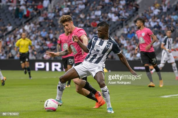 Aviles Hurtado of Monterrey fights for the ball with Angelo Sagal of Pachuca during the 13th round match between Monterrey and Pachuca as part of the...