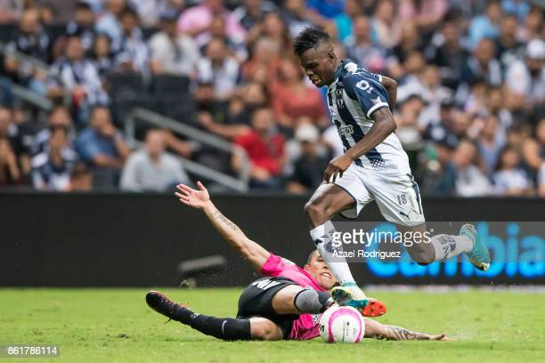 Aviles Hurtado of Monterrey fights for the ball with Edson Puch of Pachuca during the 13th round match between Monterrey and Pachuca as part of the...
