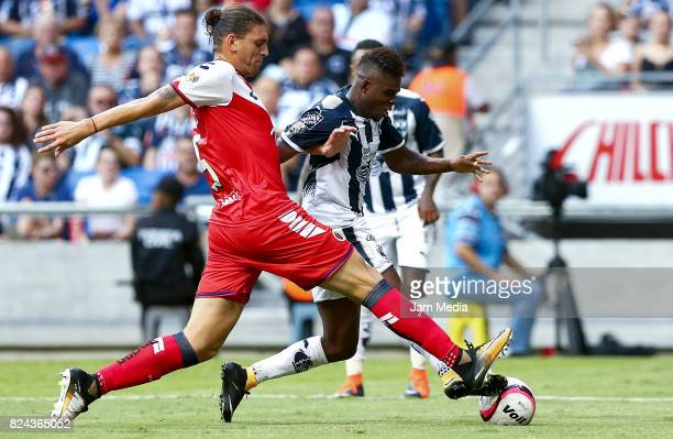 Aviles Hurtado of Monterrey fights for the ball with Guido Milan of Veracruz during the 2nd round match between Monterrey and Veracruz as part of the...