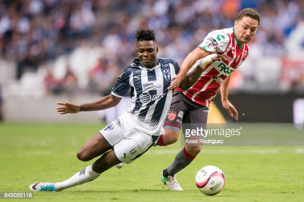 Aviles Hurtado of Monterrey fights for the ball with Manuel Iturra of Necaxa during the 8th round match between Monterrey and Necaxa as part of the...