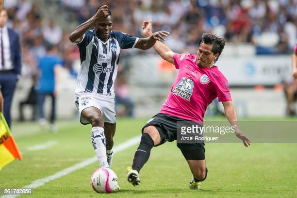 Aviles Hurtado of Monterrey fights for the ball with Omar Gonzalez of Pachuca during the 13th round match between Monterrey and Pachuca as part of...