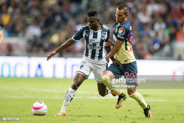 Aviles Hurtado of Monterrey fights for the ball with Paul Aguilar of America during the 15th round match between Monterrey and America as part of the...