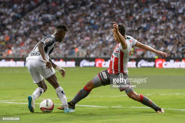 Aviles Hurtado of Monterrey fights for the ball with Xavier Baez of Necaxa during the 8th round match between Monterrey and Necaxa as part of the...