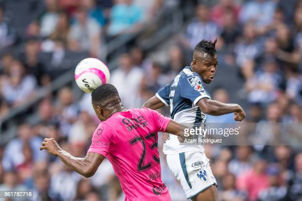Aviles Hurtado of Monterrey heads the ball with Oscar Murillo of Pachuca during the 13th round match between Monterrey and Pachuca as part of the...