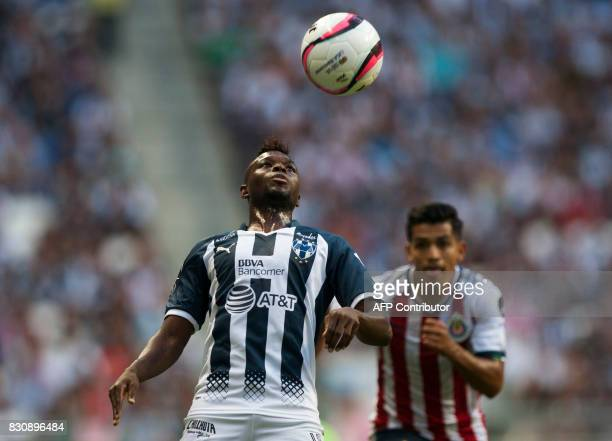 Aviles Hurtado of Monterrey vies for the ball with Jesus Sanchez of Chivas during their Mexican Apertura 2017 tournament football match in Monterrey...