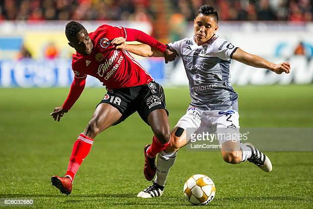 Aviles Hurtado of Tijuana and Efrain Velarde of Leon fight for the ball during the quarter finals second leg match between Tijuana and Leon as part...