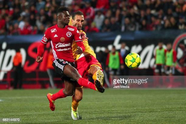 Aviles Hurtado of Tijuana and Emanuel Loeschbor of Morelia fight for the ball during the quarter finals second leg match between Tijuana and Morelia...