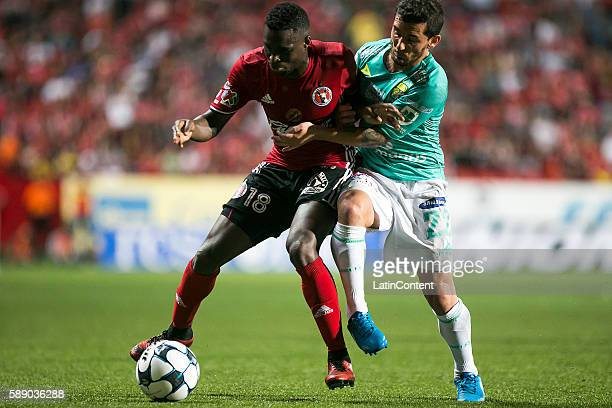Aviles Hurtado of Tijuana and Juan Cuevas of Leon fight for the ball during the 5th round match between Tijuana and Leon as part of the Torneo...