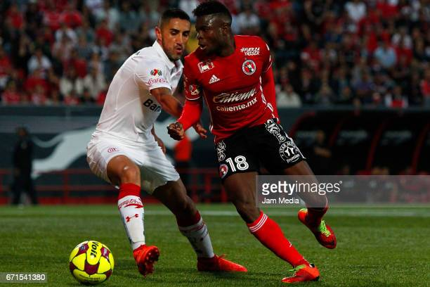 Aviles Hurtado of Tijuana and Osvaldo Gonzalez of Toluca fight for the ball during the 15th round match between Tijuana and Toluca as part of the...
