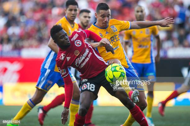 Aviles Hurtado of Tijuana and Victor Sosa of Tigres fight for the ball during the semi finals second leg match between Tijuana and Tigres UANL as...