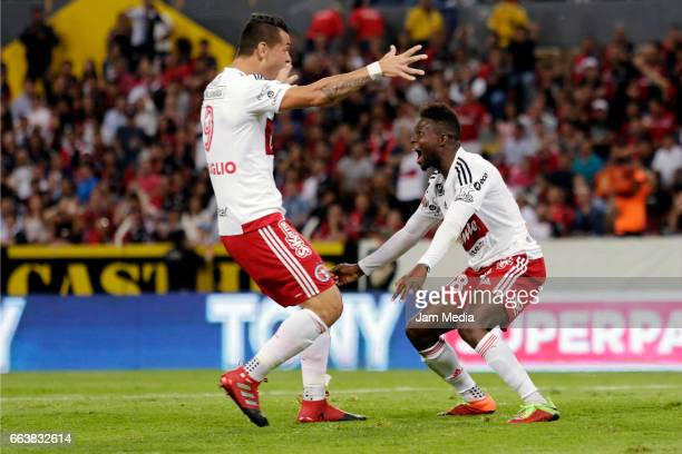 Aviles Hurtado of Tijuana celebrates after scoring the first goal of his team during the 12th round match between Atlas and Tijuana as part of the...