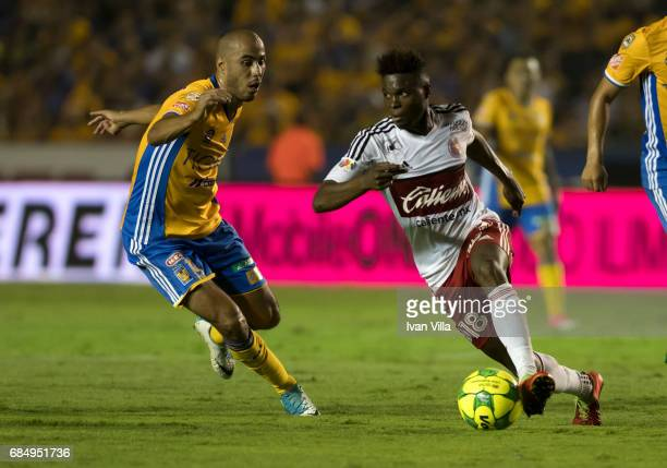 Aviles Hurtado of Tijuana fights for the ball with Guido Pizarro of Tigres during the semi finals first leg match between Tigres UANL and Tijuana as...