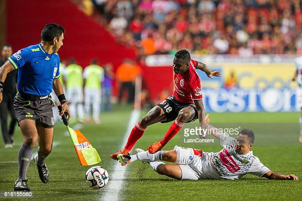 Aviles Hurtado of Tijuana fights for the ball with William Paredes of Chiapas during the 14th round match between Tijuana and Chiapas as part of the...