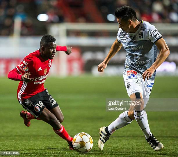 Aviles Hurtado of xolos and Efrain velarde of Leon vie for the ball during the quarter finals second leg match between Tijuana and Leon as part of...