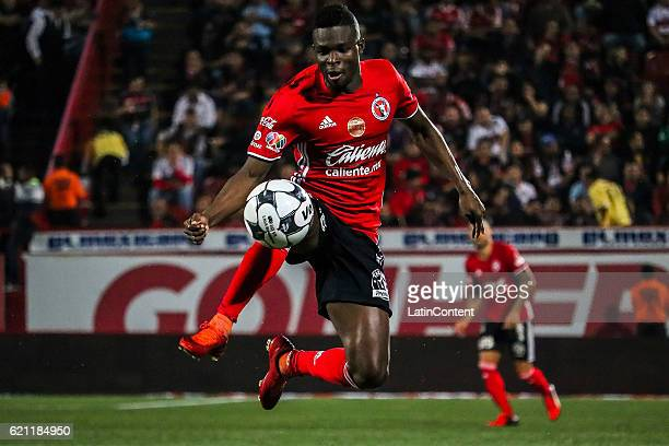 Aviles Hurtado of Xolos controls the ball during the 16th round match between Tijuana and Tigres UANL as part of the Torneo Apertura 2016 Liga MX at...