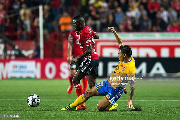 Aviles Hurtado of Xolos fights for the ball with Lucas Zelarayan of Tigres during the 16th round match between Tijuana and Tigres UANL as part of the...