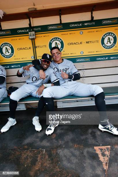 Avisail Garcia and Alen Hanson of the Chicago White Sox sit in the dugout prior to the game against the Oakland Athletics at the Oakland Alameda...