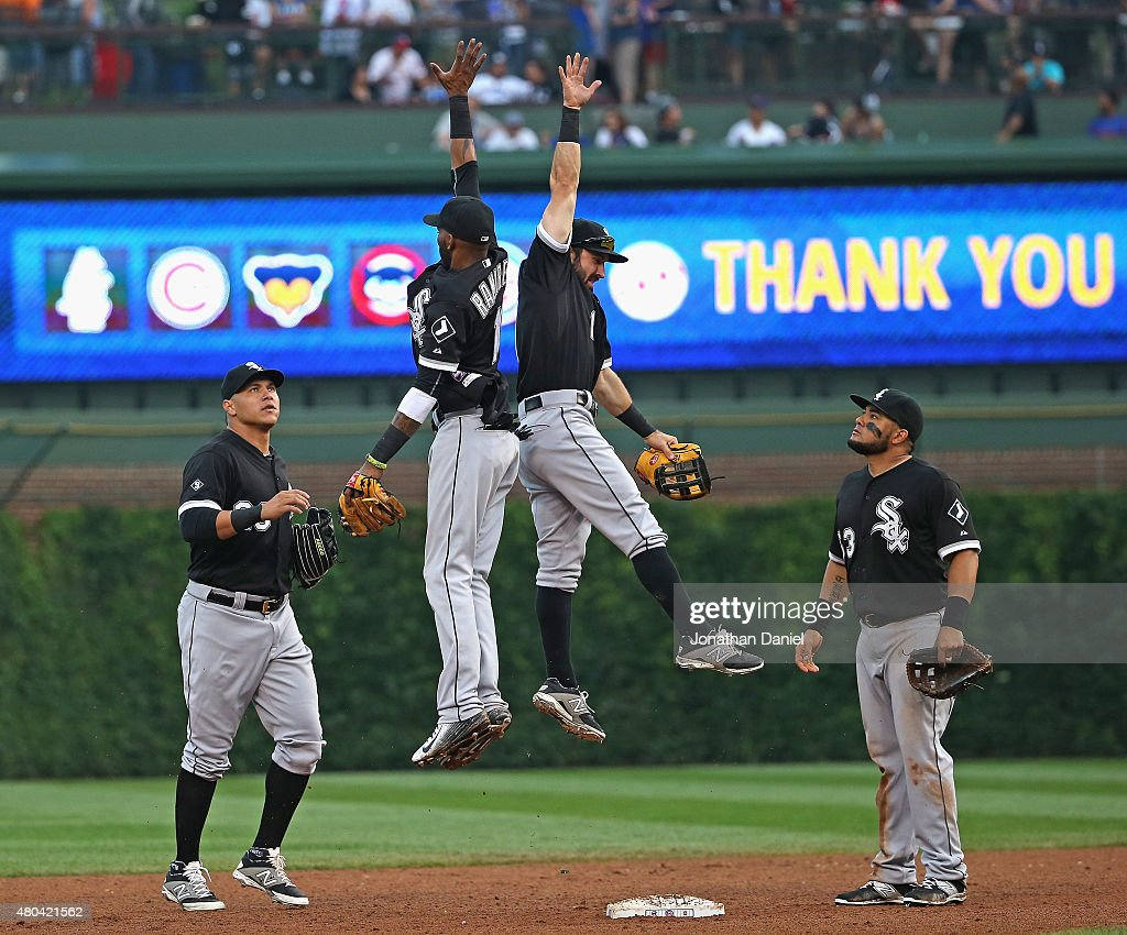 Avisail Garcia #26 (L) and <a gi-track='captionPersonalityLinkClicked' href=/galleries/search?phrase=Melky+Cabrera&family=editorial&specificpeople=453444 ng-click='$event.stopPropagation()'>Melky Cabrera</a> #53 of the Chicago White Sox watch as <a gi-track='captionPersonalityLinkClicked' href=/galleries/search?phrase=Alexei+Ramirez&family=editorial&specificpeople=690568 ng-click='$event.stopPropagation()'>Alexei Ramirez</a> #10 (L) and <a gi-track='captionPersonalityLinkClicked' href=/galleries/search?phrase=Adam+Eaton&family=editorial&specificpeople=210898 ng-click='$event.stopPropagation()'>Adam Eaton</a> #1 leap in celebration after a win over the Chicago Cubs at Wrigley Field on July 11, 2015 in Chicago, Illinois. The White Sox defeated the Cubs 5-1.