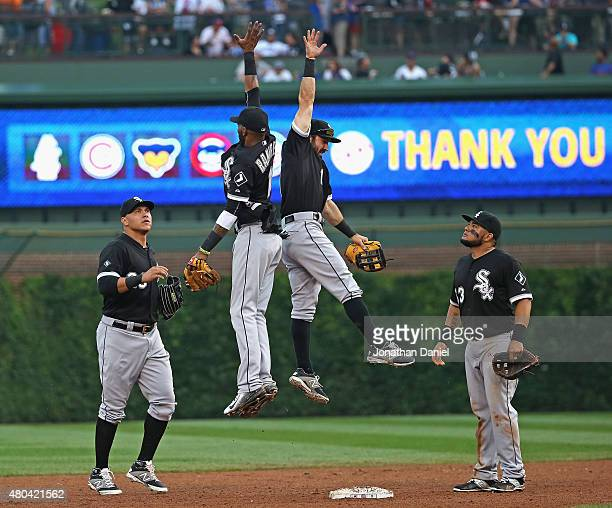Avisail Garcia and Melky Cabrera of the Chicago White Sox watch as Alexei Ramirez and Adam Eaton leap in celebration after a win over the Chicago...
