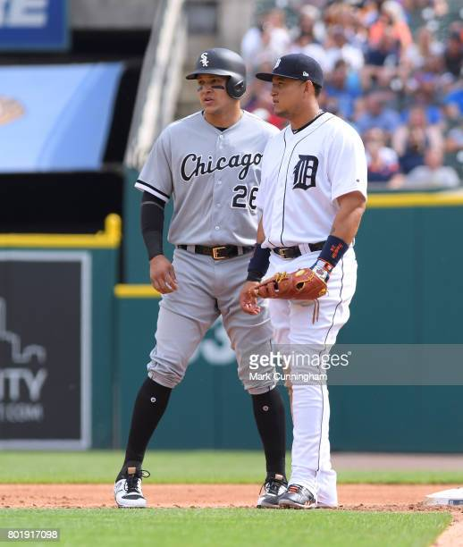 Avisail Garcia of the Chicago White Sox and Miguel Carera of the Detroit Tigers stand together on the field during the game at Comerica Park on June...