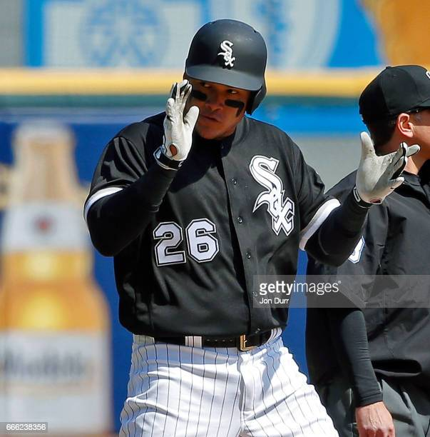 Avisail Garcia of the Chicago White Sox celebrates after hitting an RBI triple against the Minnesota Twins during the second inning at Guaranteed...