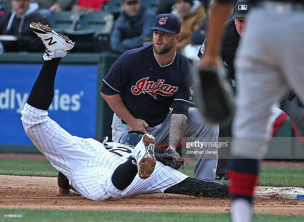 Avisail Garcia #26 of the Chicago White Sox gets picked off at first base on the tag by <a gi-track='captionPersonalityLinkClicked' href=/galleries/search?phrase=Mike+Napoli&family=editorial&specificpeople=525007 ng-click='$event.stopPropagation()'>Mike Napoli</a> #26 of the Cleveland Indians in the 2nd inning during the home opener at U.S. Cellular Field on April 8, 2016 in Chicago, Illinois.