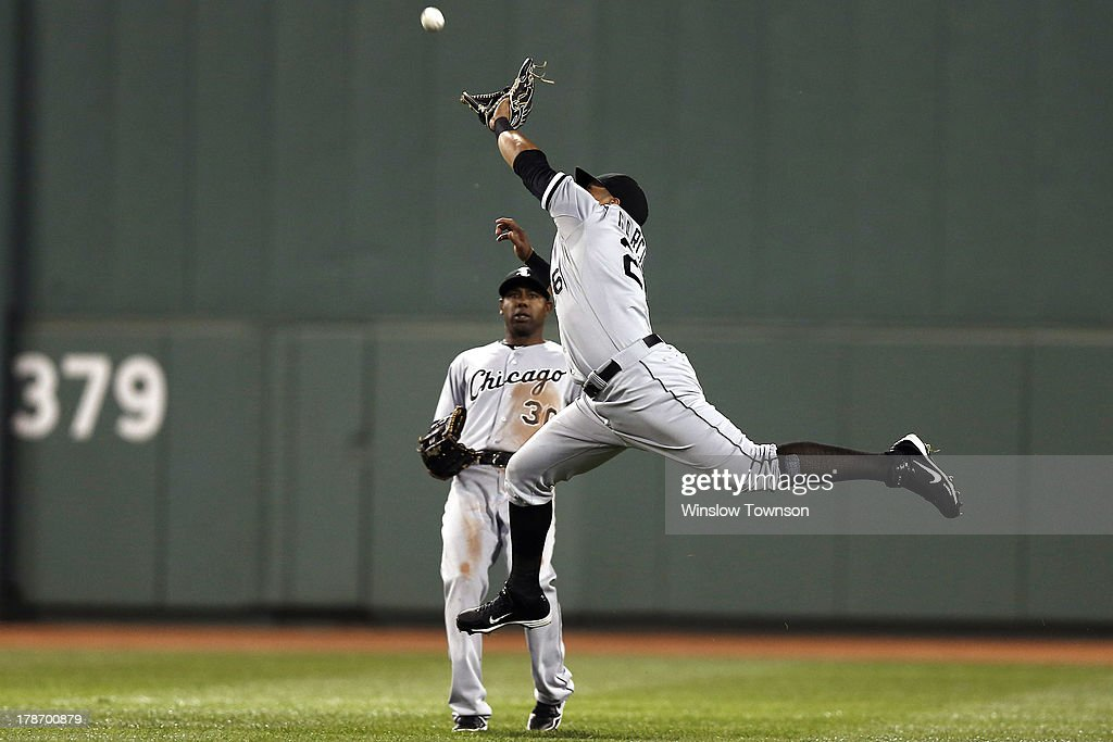 Avisail Garcia #26 of the Chicago White Sox goes for a hit by Stephen Drew #7 of the Boston Red Sox (not pictured), which fell for a single as <a gi-track='captionPersonalityLinkClicked' href=/galleries/search?phrase=Alejandro+De+Aza&family=editorial&specificpeople=4181650 ng-click='$event.stopPropagation()'>Alejandro De Aza</a> #30 of the White Sox looks on during the second inning at Fenway Park on August 30, 2013 in Boston, Massachusetts.
