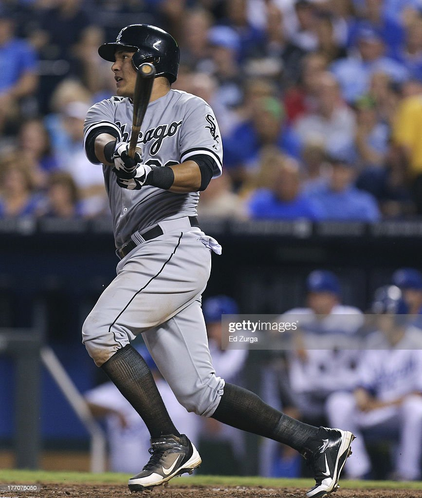 Avisail Garcia #26 of the Chicago White Sox hits a single in the fourth inning against the Kansas City Royals at Kauffman Stadium August 20, 2013 in Kansas City, Missouri.