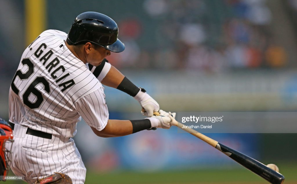 Avisail Garcia #26 of the Chicago White Sox hits a two-run home run in the 1st inning against the Baltimore Orioles at U.S. Cellular Field on August 20, 2014 in Chicago, Illinois.