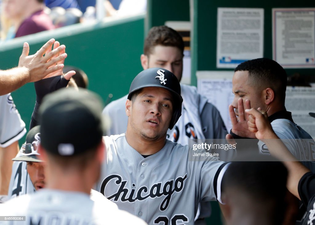 Avisail Garcia #26 of the Chicago White Sox is congratulated by teammates in the dugout after scoring during the 3rd inning of the game at Kauffman Stadium on September 13, 2017 in Kansas City, Missouri.