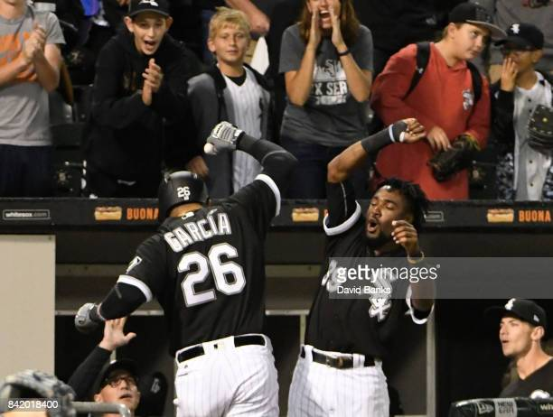 Avisail Garcia of the Chicago White Sox is greeted by Alen Hanson of the Chicago White Sox after hitting a tworun homer during the seventh inning on...