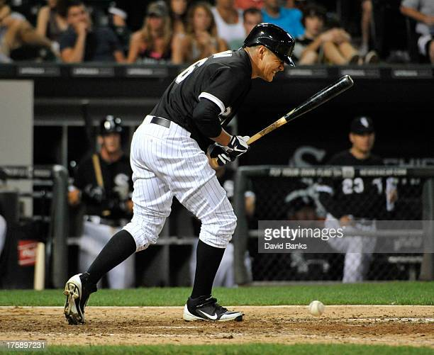Avisail Garcia of the Chicago White Sox reacts after getting hit by a pitch during the tenth inning against the Minnesota Twins in the second game of...