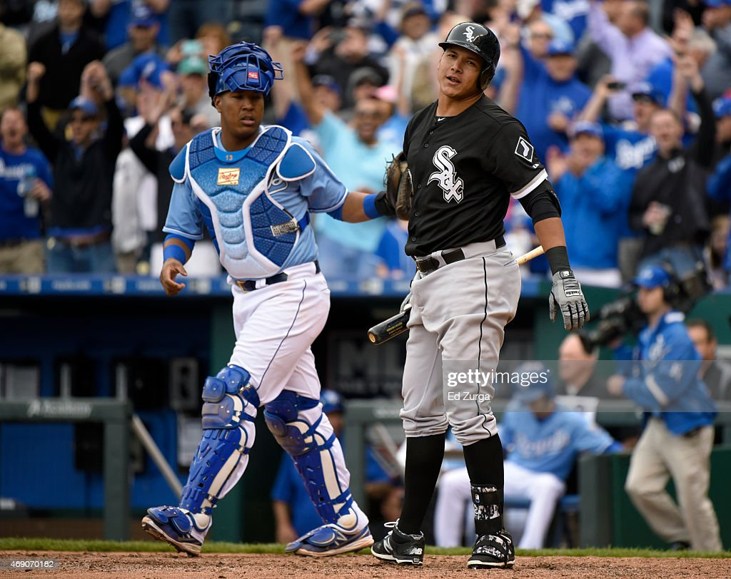 Avisail Garcia #26 of the Chicago White Sox reacts after striking out to end the game as Salvador Perez #13 of the Kansas City Royals heads to the mound on April 9, 2015 at Kauffman Stadium in Kansas City, Missouri. The Royals won 4-1 and took the the tree game series.